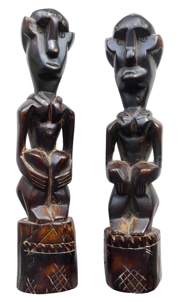 Pair of Sumban Seated Ancestor Figures
